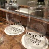 洗面化粧台備え付けグラスがオリジナルデザインのディスポーザブルカップ(使い捨てカップ)になりました